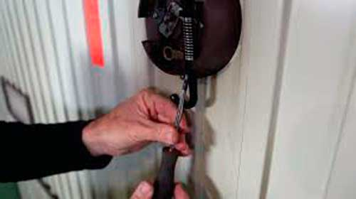 cerradura roper puerta basculante